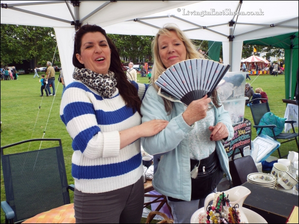 Mother and daughter selling their wares with a smile! Oh and a fan...